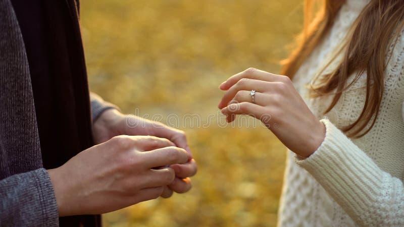 Girl with wedding ring, boyfriend proposing in autumn woods, romance, closeup. Stock photo stock image