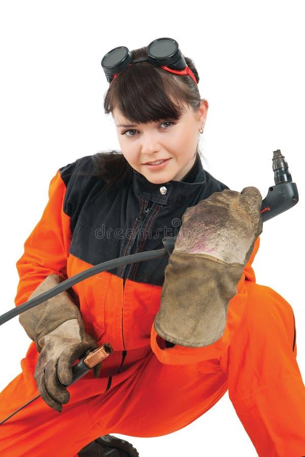 Girl welder working with burner royalty free stock image