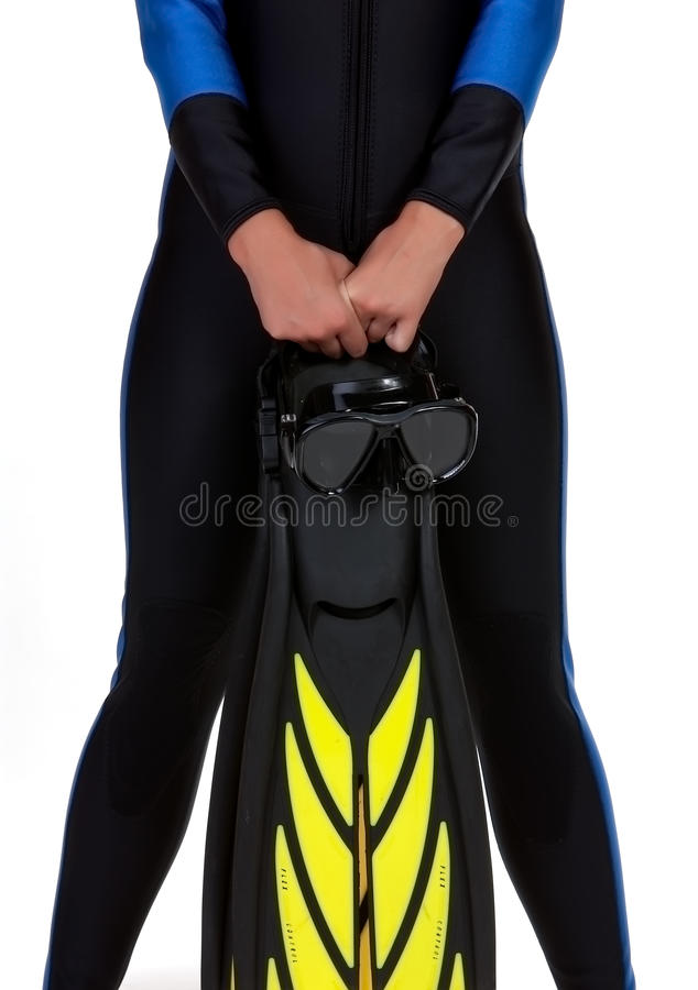 Girl in the wet suit holding mask and fins royalty free stock image