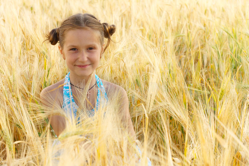 Download Girl on a wheat field stock image. Image of blue, lips - 20037119