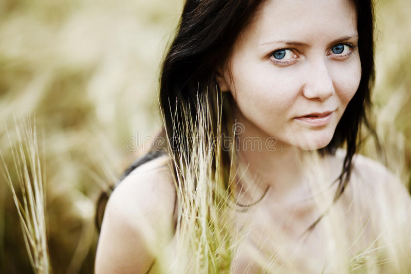 Download Girl in the wheat field stock image. Image of people - 22335083