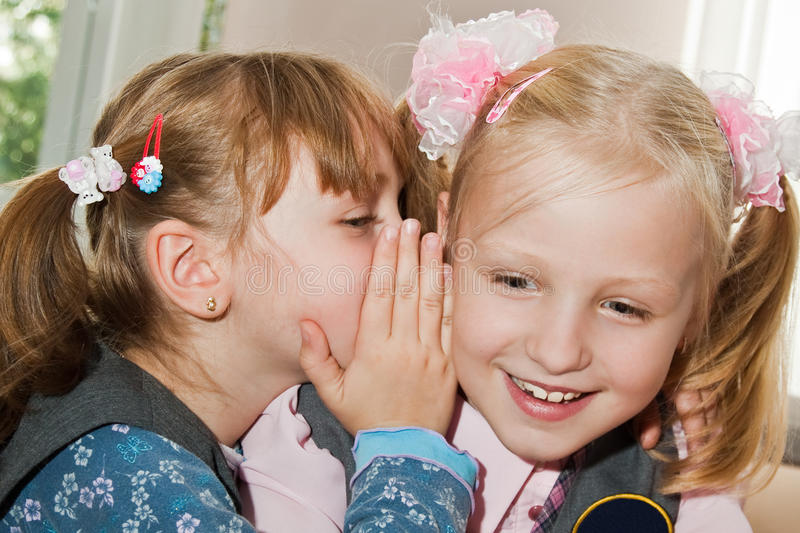 Download A Girl Whispers In Her Girlfriend's Ear Stock Photography - Image: 16767702