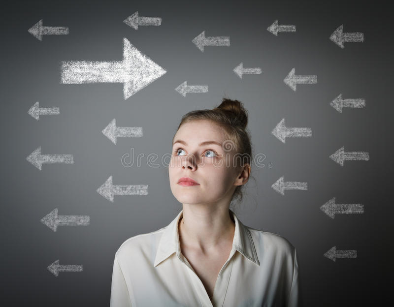 Girl in white and arrows. stock image