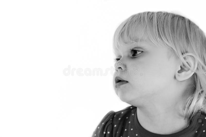Girl on a white background. Little girl on an isolated white background stock photography