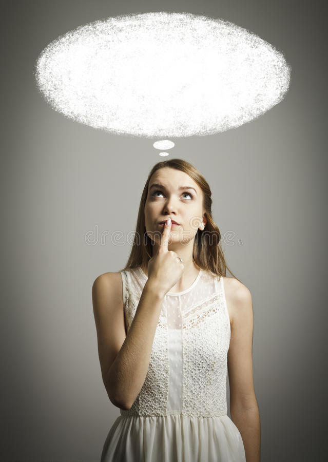 Girl in white and blank SPEECH BUBBLE stock photos