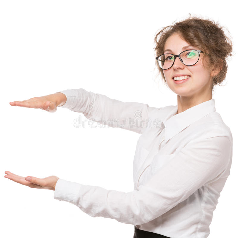 Girl in a white blouse stands on a white background, gestures, emotions on her face. Girl in white blouse stands on white background, gestures, emotions on face royalty free stock images