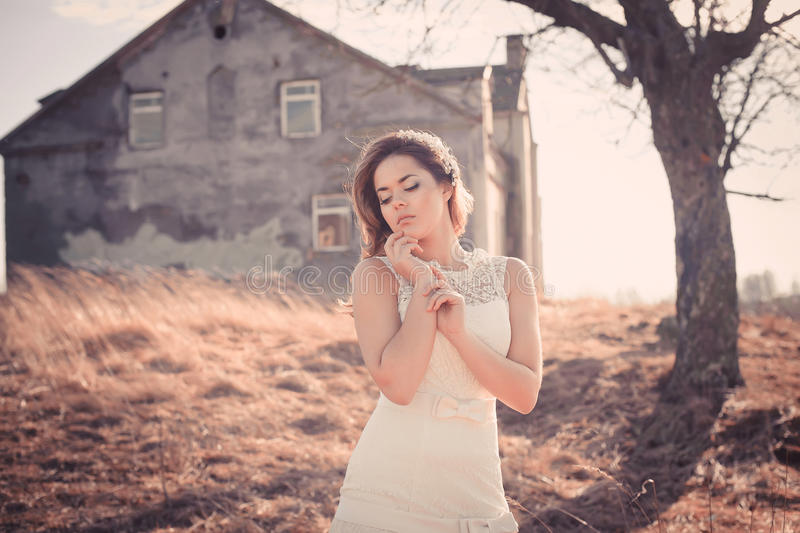 Girl in white dress. Bride in the park. Photo in vintage style. Mystery. Wedding day. Bride. White dress royalty free stock photography