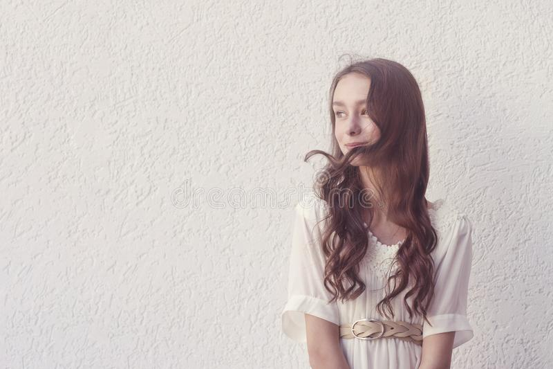Girl in white dress stock image