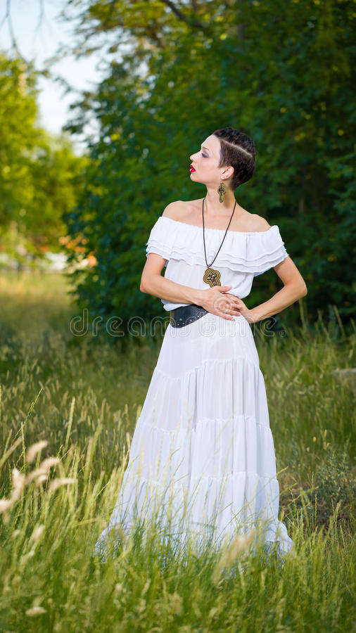 Girl in a White Dress on Nature royalty free stock image