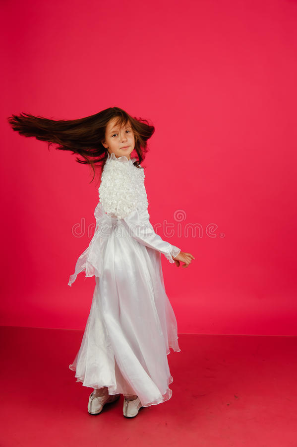 The Girl In A White Dress On A Pink Background Stock Image