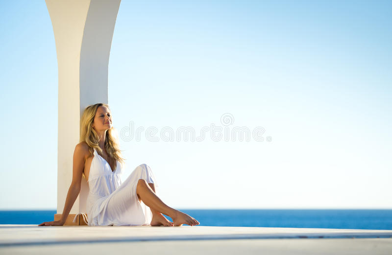 Girl In White Dress At Sunset By The Sea 4 Stock Image