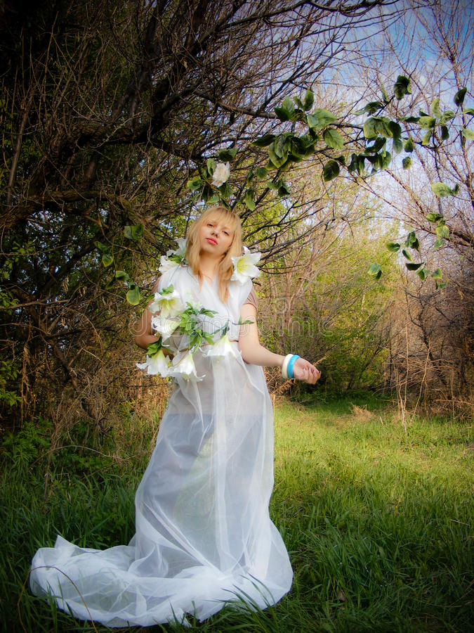 Download A Girl In A White Dress In The Woods With Flowers Stock Image - Image: 25280657