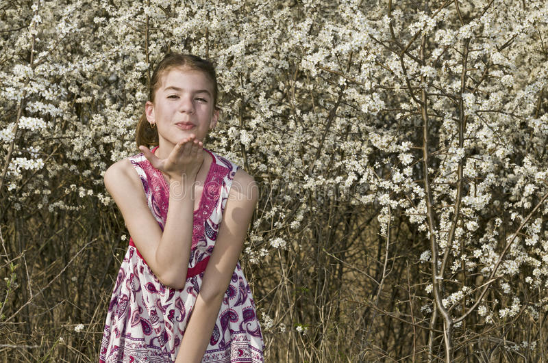Download Girl With White Flowers Throwing Kiss Stock Photography - Image: 30647262
