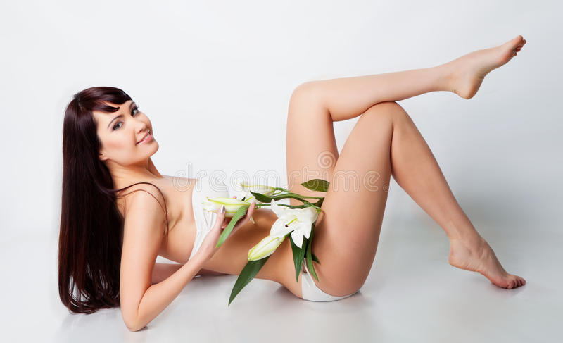 Girl With White Lily Stock Image
