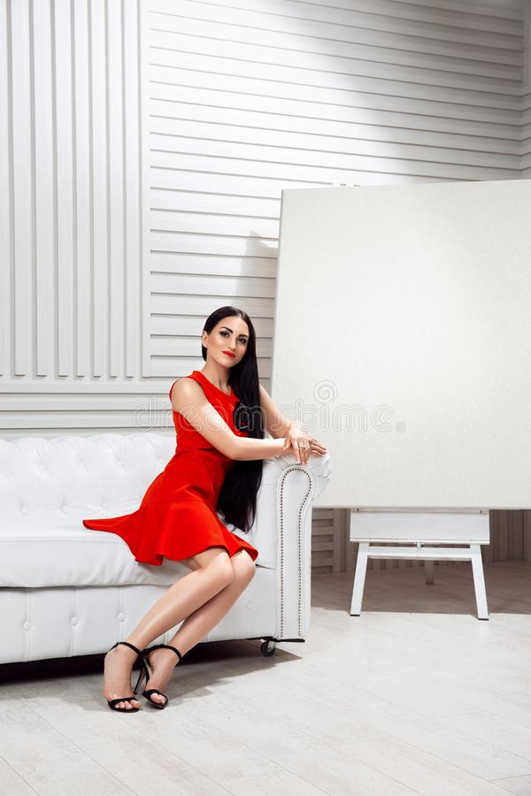 The girl in the white room stock image