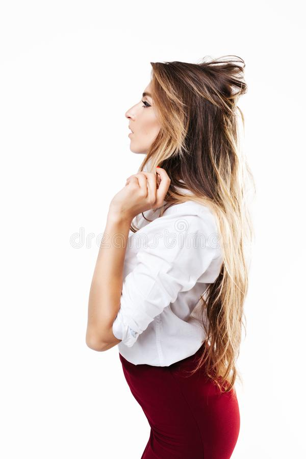Girl in white shirt and burgundy skirt on an isolated white background stock photography
