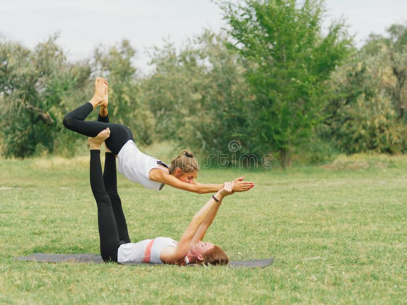 Lifestyle, sport and people concept: Young couple in yoga pose. stock photos