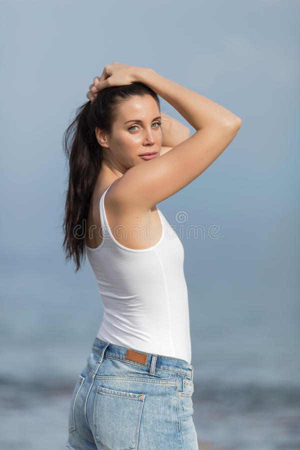 Download Girl In White Tank Top And Jeans Shorts Stock Image - Image: 83707419