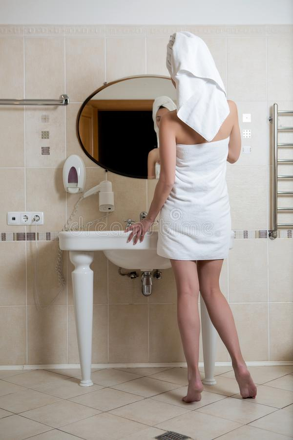 Girl in white towel standing stock image
