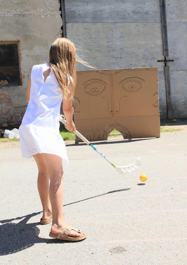 Girl in white training floorball royalty free stock images
