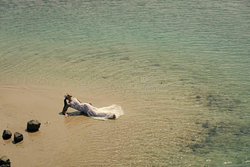 Girl in white wedding dress stock photo