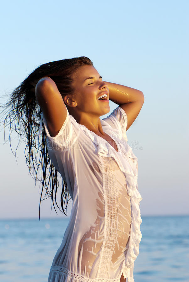 Girl In A White Wet Transparent Dress Stock Images