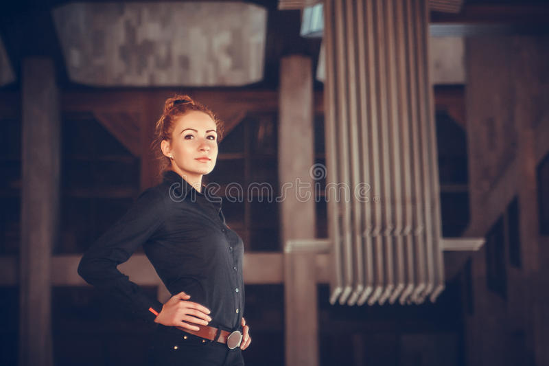 Girl whith red haire city portrait. Portrait of red-haired girl on the background of the city building royalty free stock photos