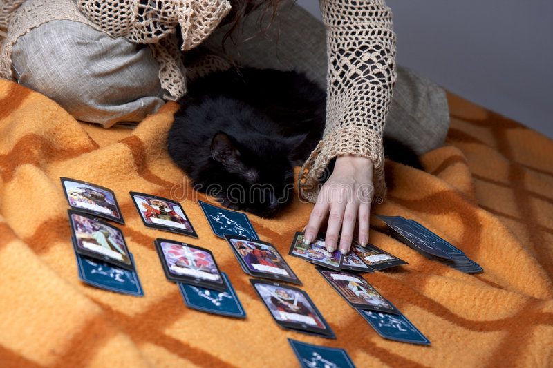 Girl who read the cards. Picture of a girl who read the cards royalty free stock images