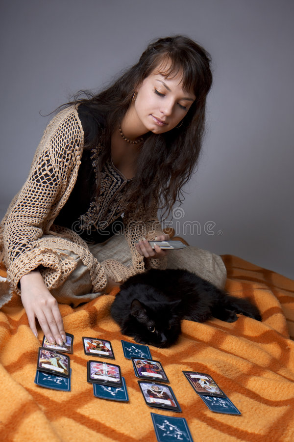 Girl who read the cards. Picture of a girl who read the cards royalty free stock photography