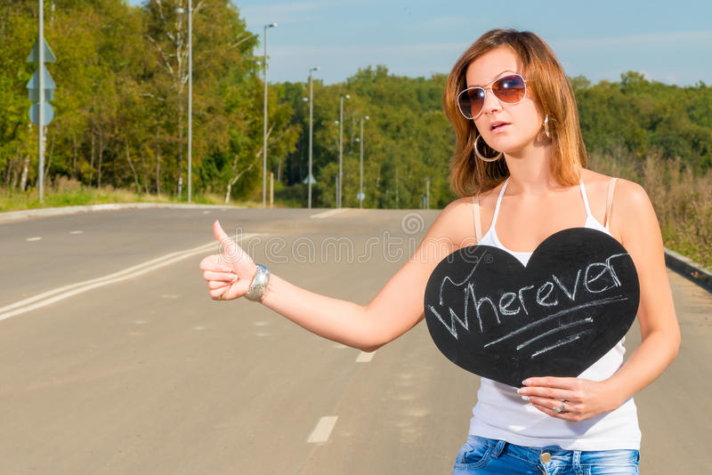 Girl who travels hitchhiking. Portrait of a beautiful young girl who travels hitchhiking royalty free stock photos