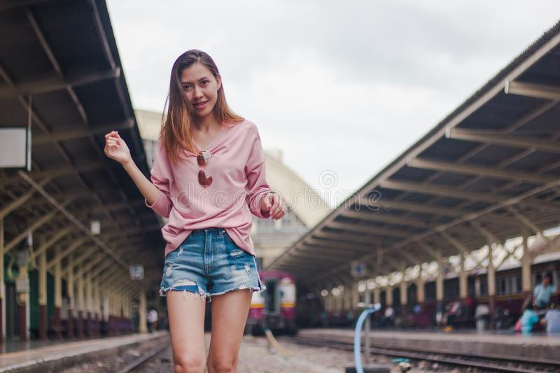 Woman standing on a railroad track royalty free stock photo