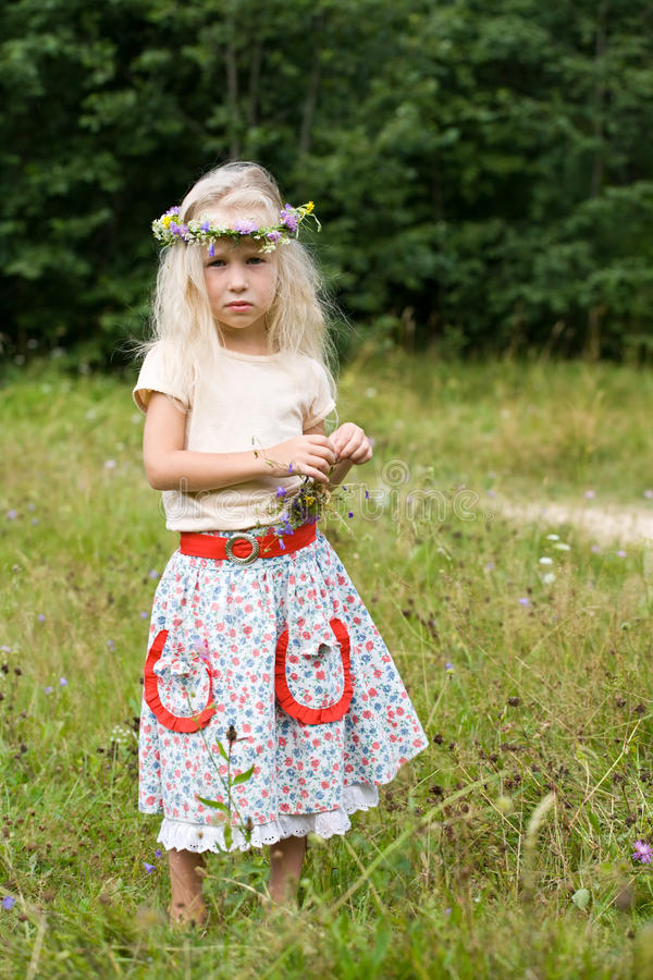 Girl in wild flowers wreath stock image