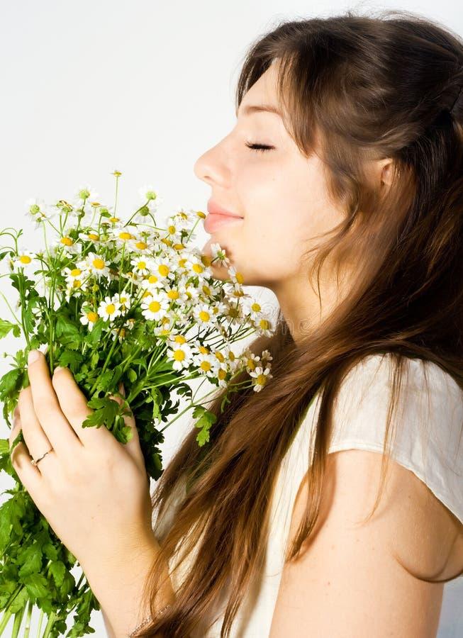 Girl and wildflowers stock photos