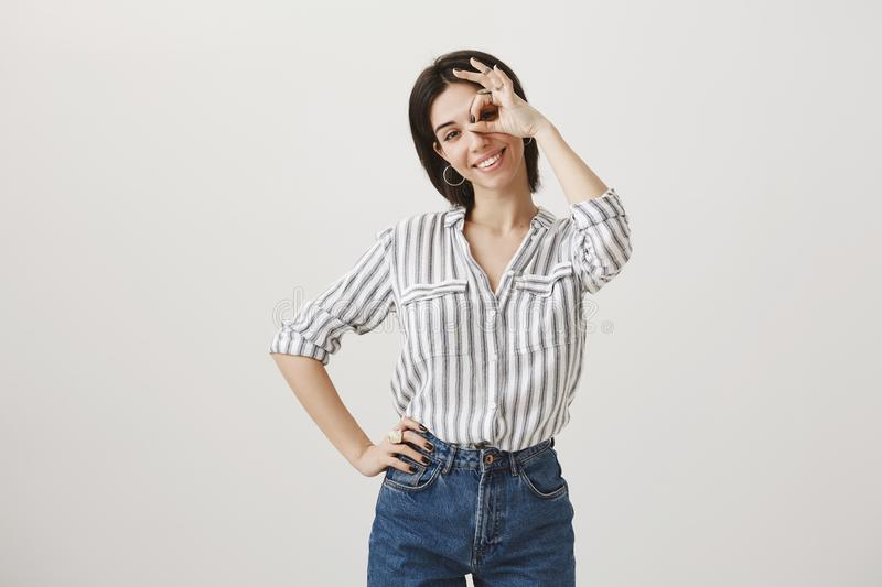 Girl will deal with every sort of problems easily. Portrait of happy confident caucasian female office assistant showing royalty free stock image