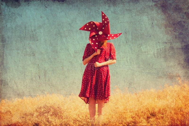 Girl with wind turbine stock photo