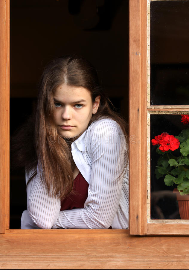 Girl in the window royalty free stock photo