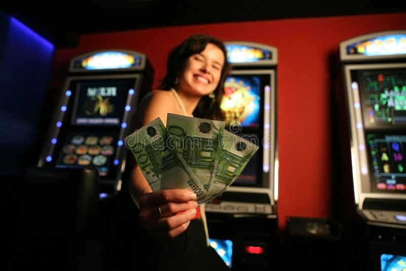 Girl winning money. Casino shot,focus on money stock image