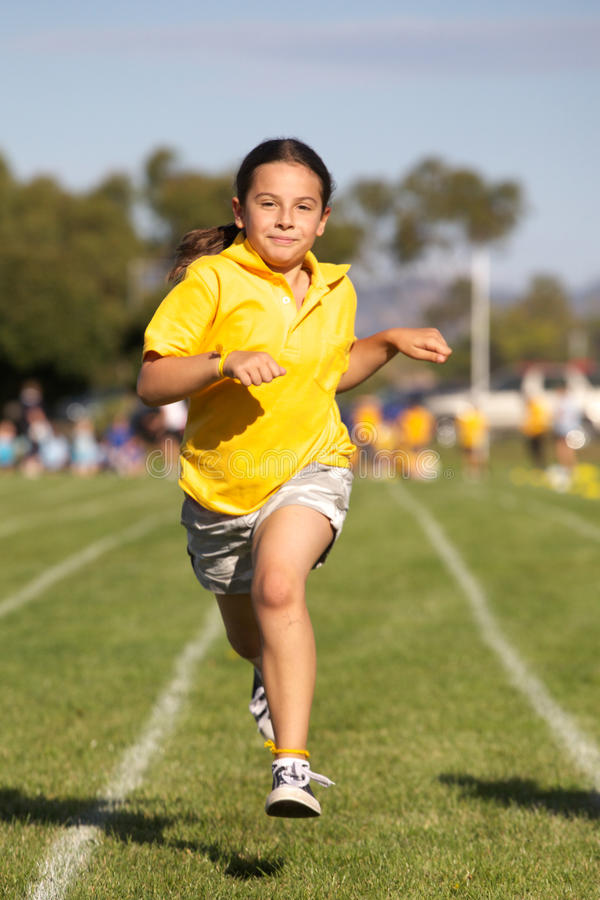 Girl winning sports race stock photo