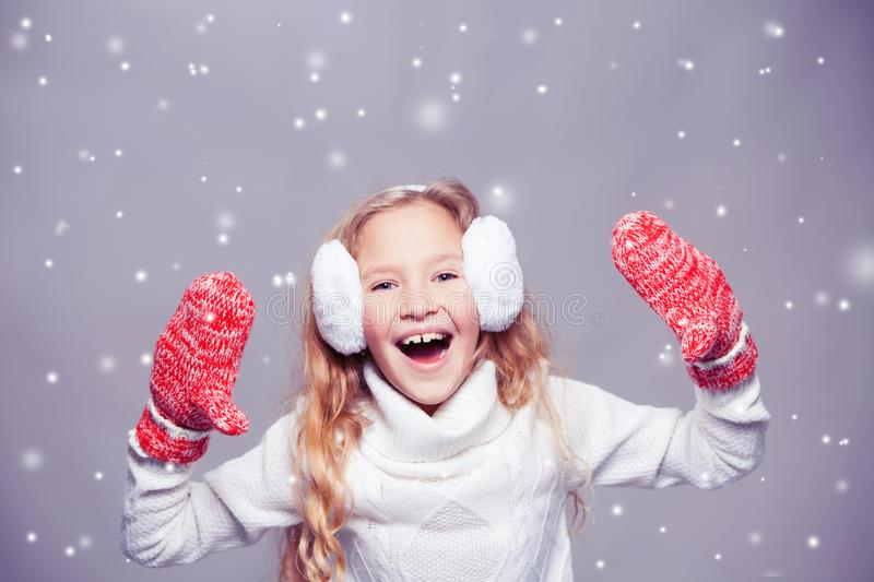 Girl in winter clothes stock image