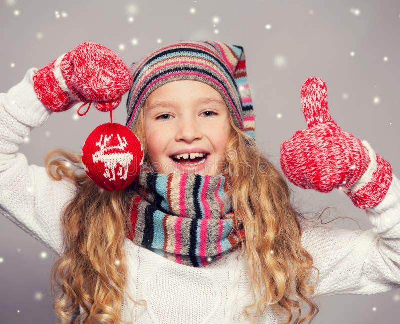 Girl in winter clothes stock photos