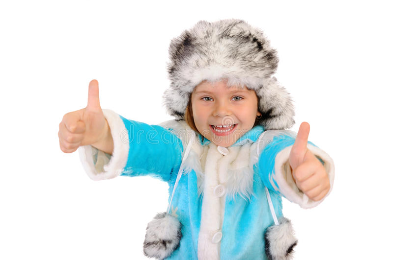 The girl in winter clothes shows sign OK royalty free stock image