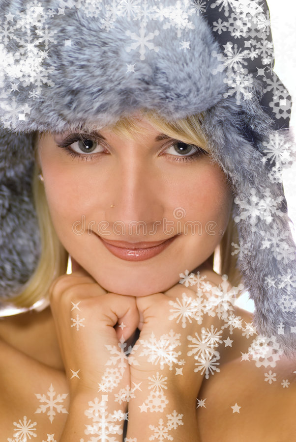 Girl in winter fur-cap. Beautiful young girl in winter fur-cap royalty free stock photo