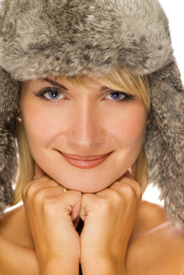 Girl in winter fur-cap. Picture of a Beautiful girl in winter fur-cap stock image