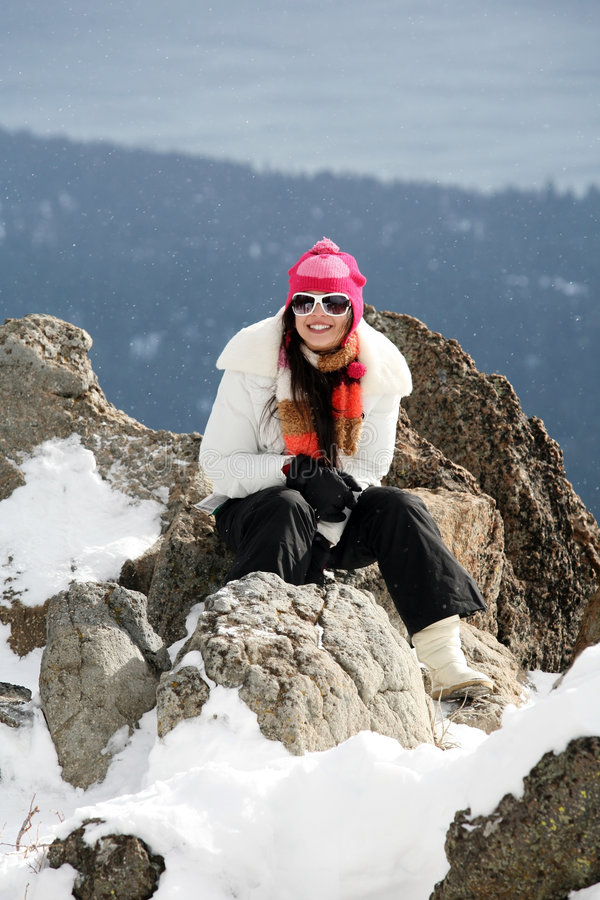 Girl in winter mountains stock photo