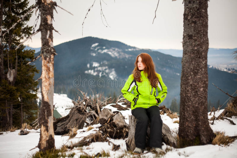 The girl in the winter in the mountains royalty free stock image