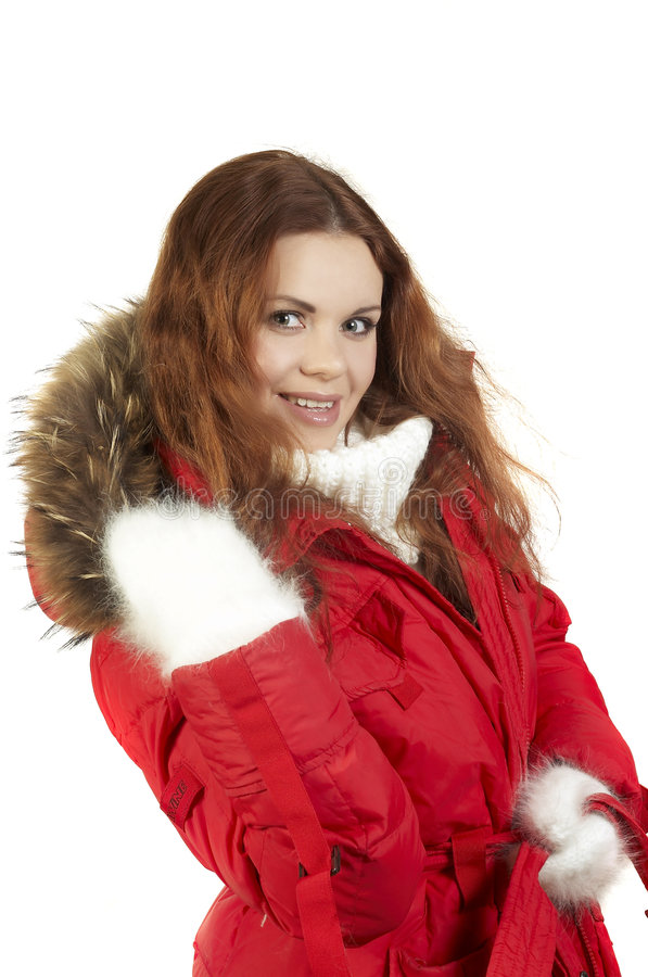 Girl in a Winter sports jacket. Portrait of the beautiful girl in a red winter jacket and fur collar stock photos