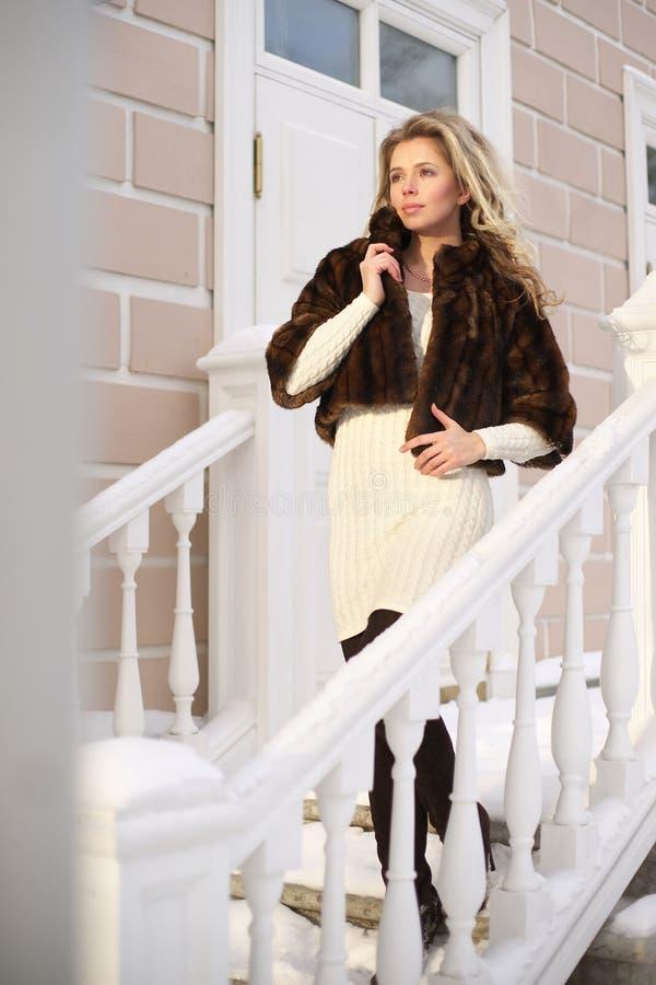Girl in winter sunlight stock image