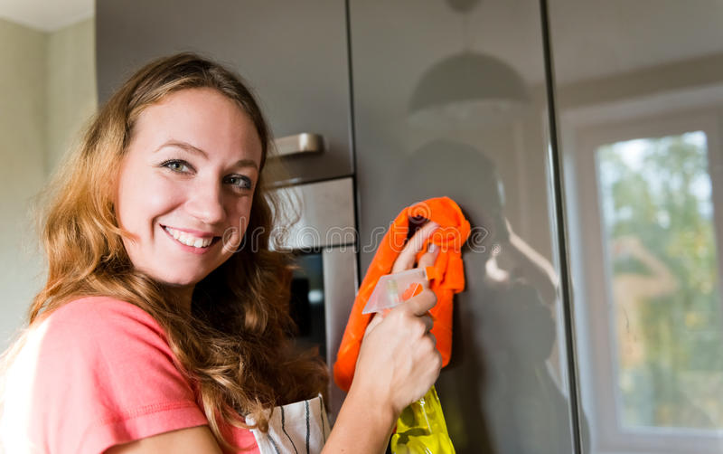 Download Girl Wiping The Dust From Furniture At Home Stock Photo - Image: 34739142