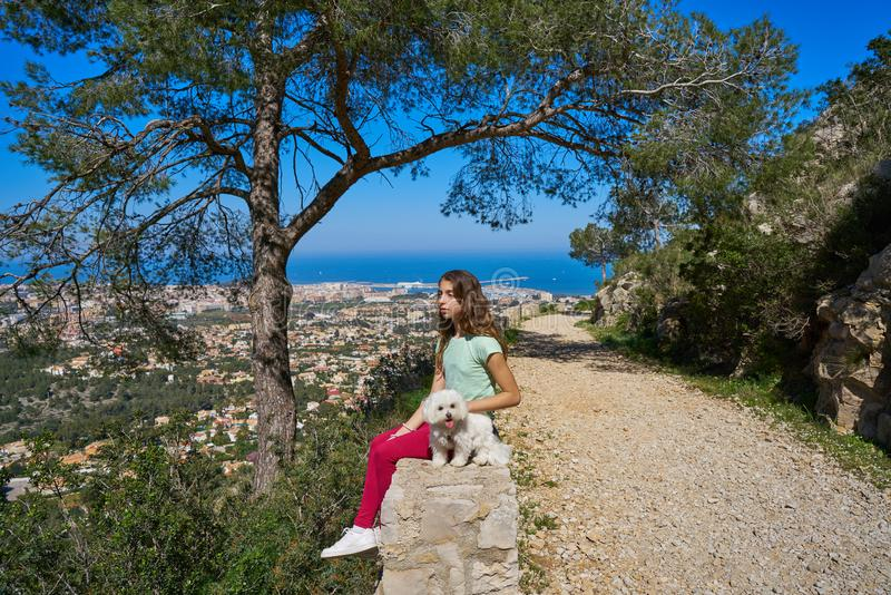 Girl wirh pet dog looking at Denia aerial view. In alicante of Spain stock photos