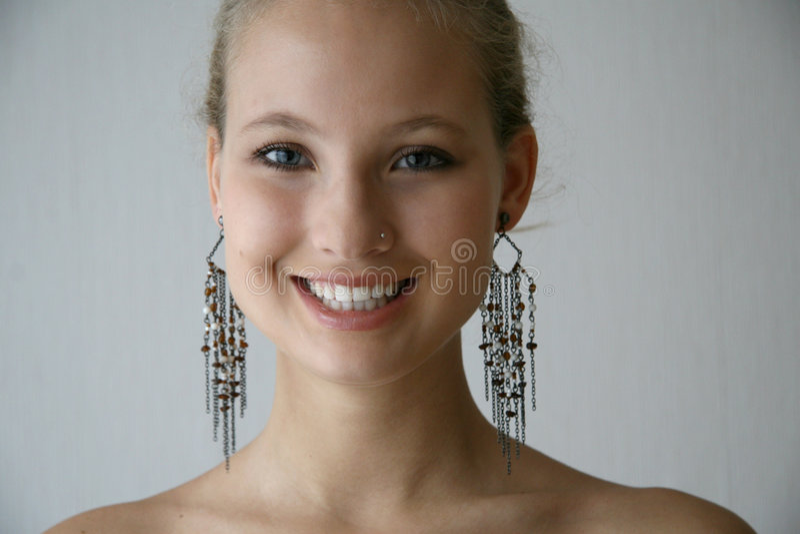 Girl wit earrings stock image